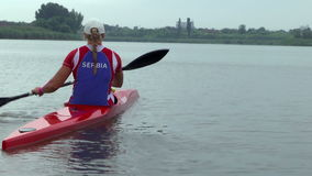 Woman Rower in training. Zabalj;Serbia; 08.03.2016.National team rowers in a kayak on the preparations for the Summer Olympic Games 2016. Video clip stock footage