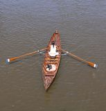 Woman rowing Stock Image