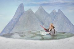 Woman in boat. A woman rowing a boat in a fantasy landscape stock photography