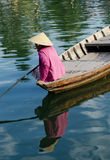 A woman rowing boat on Hoai river in Hoi An, Vietnam Royalty Free Stock Photography