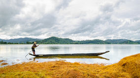 The woman rowing boat on Lak lake Royalty Free Stock Photography