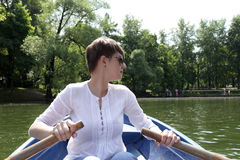 Woman rowing boat Royalty Free Stock Images