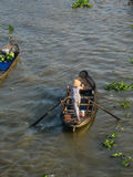 A woman rowing boat on Mekong river in Ben Tre, Vietnam Royalty Free Stock Photo