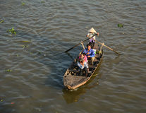 A woman rowing the boat on river in Ben Tre, Vietnam Stock Photography