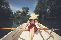 Woman rowing a boat in summer Stock Image