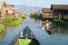 Woman on rowing a boat at the village of Maing Thauk Royalty Free Stock Images
