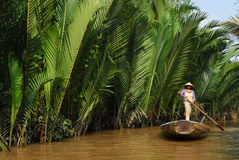 Woman rowing a gondola. On river Stock Photography