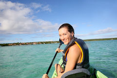 Woman rowing in the kayak Royalty Free Stock Photography