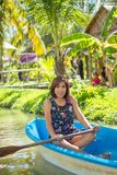 Woman rowing in the park royalty free stock image