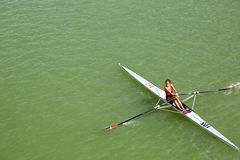 Woman rowing in Sevilla Stock Images