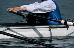 Woman rowing on a white rower Royalty Free Stock Photo