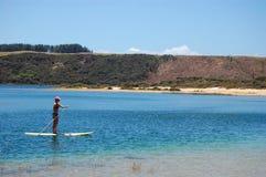 Woman rows at paddle board Royalty Free Stock Photos