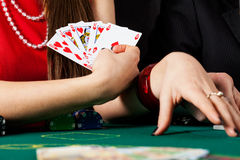 Woman with royal flush Stock Photography