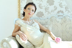 Woman in royal interior Royalty Free Stock Images