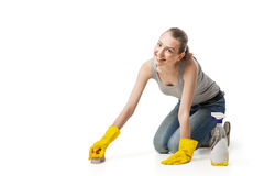 Woman in rubber glover with brush cleaning floor Stock Photos