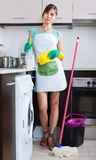 Woman in rubber gloves at kitchen Royalty Free Stock Photography