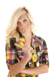 Woman with rubber mallet serious Royalty Free Stock Image