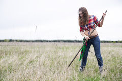 Woman at rubbers rake field with joy Stock Photography