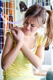 Woman rubbing aching shoulder Royalty Free Stock Image