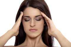 Woman rubbing forehead Royalty Free Stock Photos