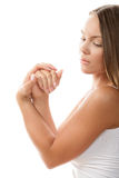 Woman rubbing her hands Royalty Free Stock Photo