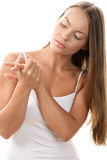 Woman rubbing her hands Stock Photos