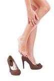 Woman rubbing her leg Royalty Free Stock Photo