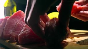 Woman rubbing tuna fillet pieces with ginger marinade. 4K close-up shot. Woman rubbing tuna fillet pieces with marinade. 4K close-up video stock video