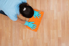 Woman Rubbing Wooden Floor With Cloth Royalty Free Stock Image