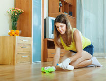 Woman rubbing wooden floor Royalty Free Stock Photos