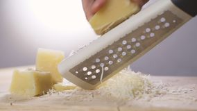 Woman Rubs Hard Grated Cheese. Hands And Grater Close-up ...