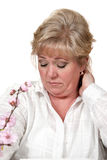 Woman rubs her neck Royalty Free Stock Photography