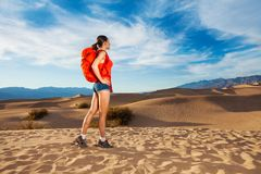 Woman with rucksack standing in Death valley Royalty Free Stock Photos