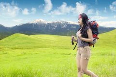 Woman with rucksack walking in nature Stock Photo