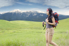 Woman with rucksack walking in nature Stock Photography