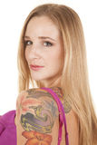 Woman ruffles tattoo close looking. Royalty Free Stock Photo