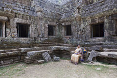 Woman at ruins of Angkor Wat Stock Photography