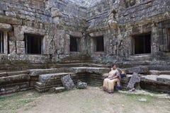 Woman at ruins of Angkor Wat Stock Photography