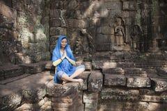 Woman at ruins of Angkor Wat Stock Photo