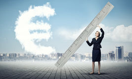Woman with ruler Royalty Free Stock Photos