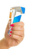 Woman rumpling a pack of cigarettes Stock Photography