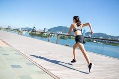 Woman run in boardwalk Royalty Free Stock Photo