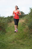 Woman On Run In Countryside Royalty Free Stock Images