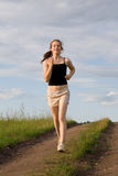Woman run in field royalty free stock photos