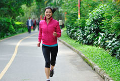 Woman runing in park Stock Image