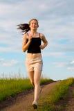 Woman run on green grass Stock Photos