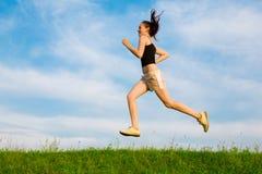 Woman run on green grass Stock Photography