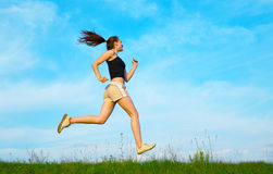 Woman run on green grass Stock Image