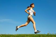 Woman run on green grass Stock Photo