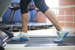 Woman run. In gym - only legs to be seen. Motion blur in limbs for dynamic Stock Photography